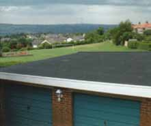 block of rubber flat roof garages
